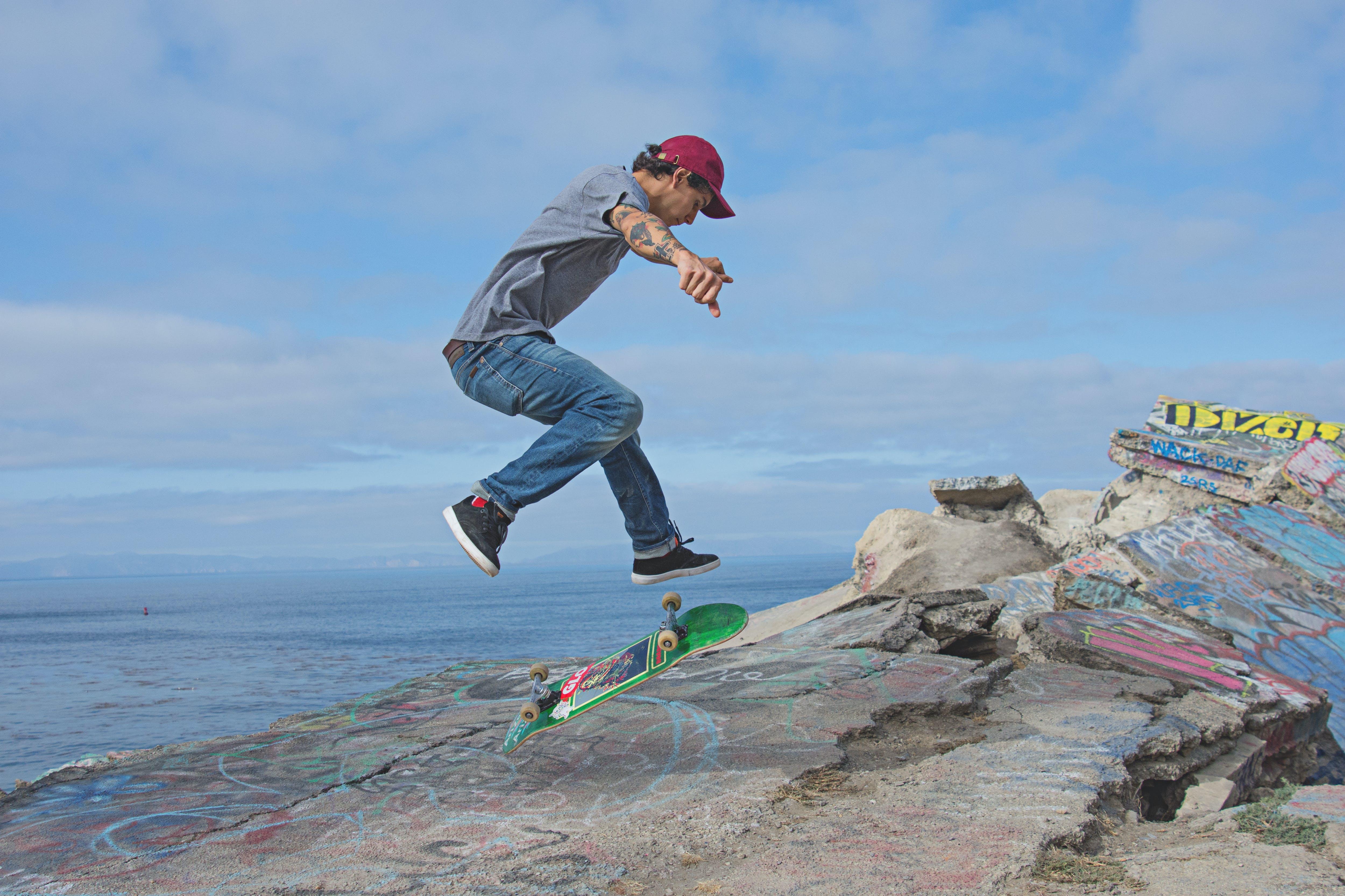 Fidelity jeans, skateboard, kick-flip