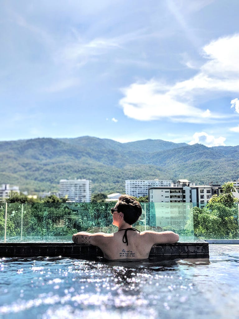 718c278c119 being a digital nomad in chiang mai thailand, in pool looking out over  mountains