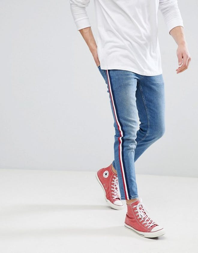 slim jeans in mid blued with wide stripe
